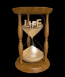 Aging and longevity concept of sand and life in an hourglass