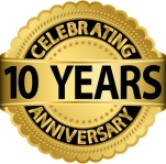 Celebrating 10 years anniversary golden label with ribbon, vecto